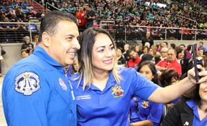 Retired NASA Astronaut Jose Hernandez poses for a selfie with District Parent Round Table Committee Member Angelica Martinez during the Edinburg CISD General Assembly at the Bert Ogden Arena in Edinburg.