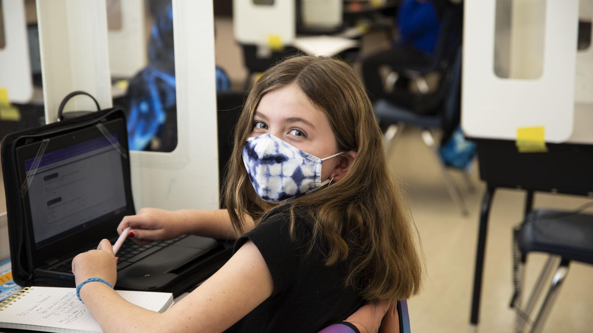 Student working on Chromebook in classroom