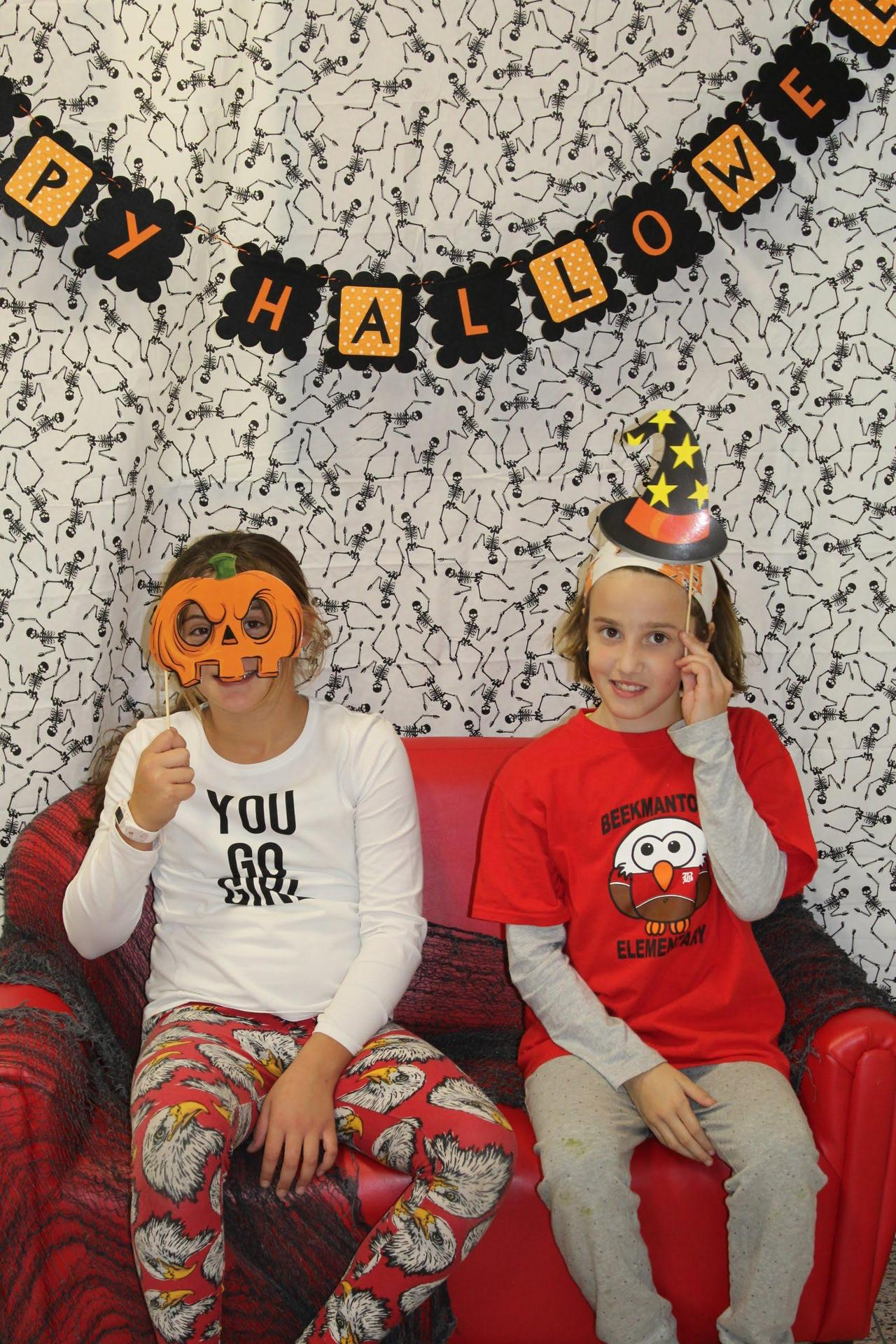 Students with Halloween masks at fall festival