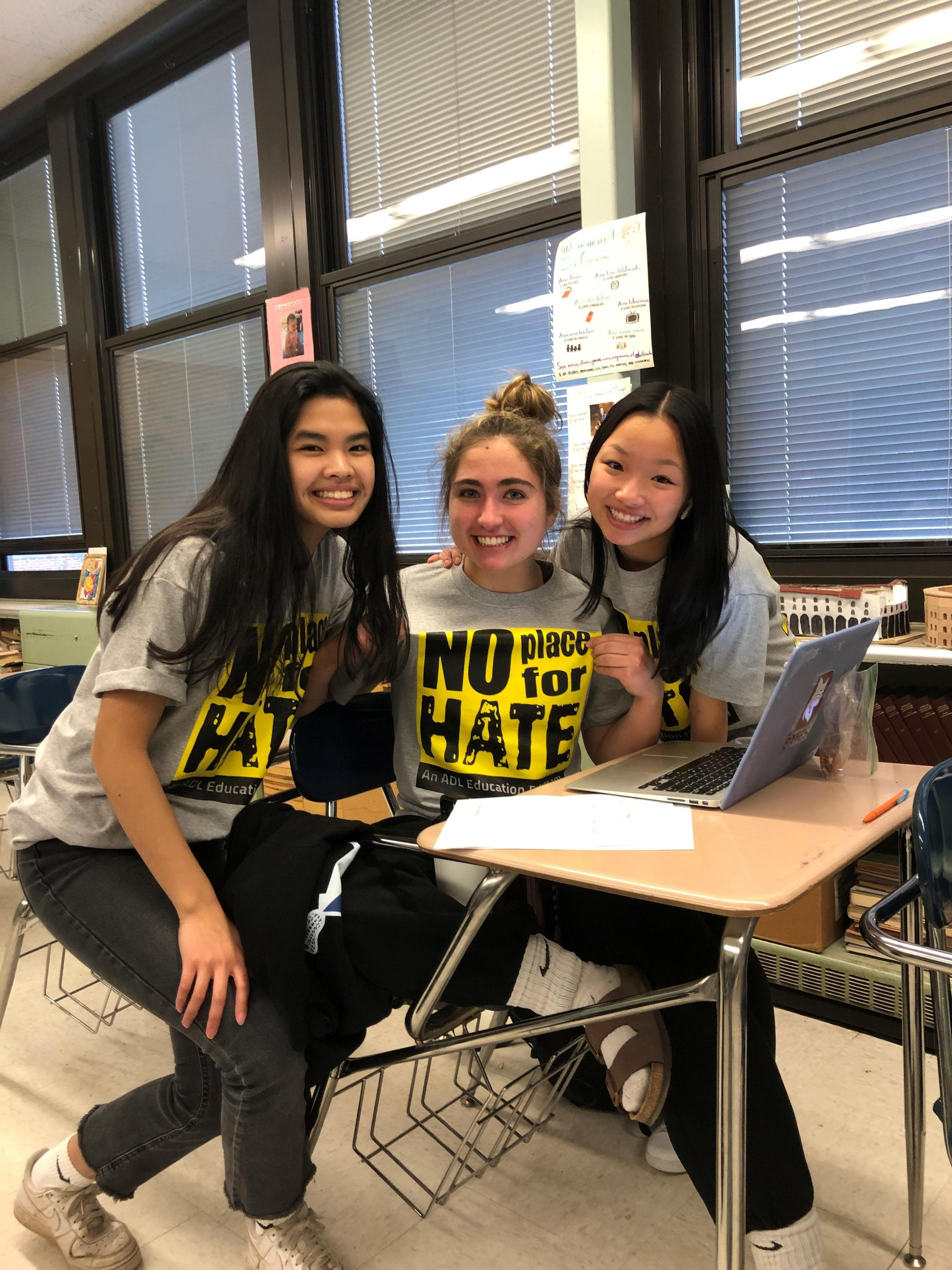 Three students with NPFH shirts on