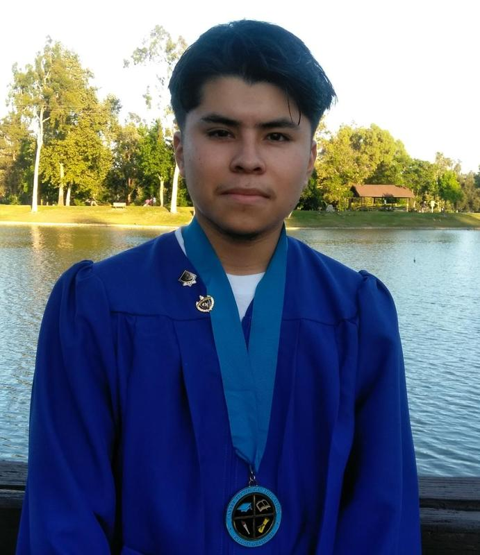 First student to earn CTE Medallion pictured in his cap and gown.