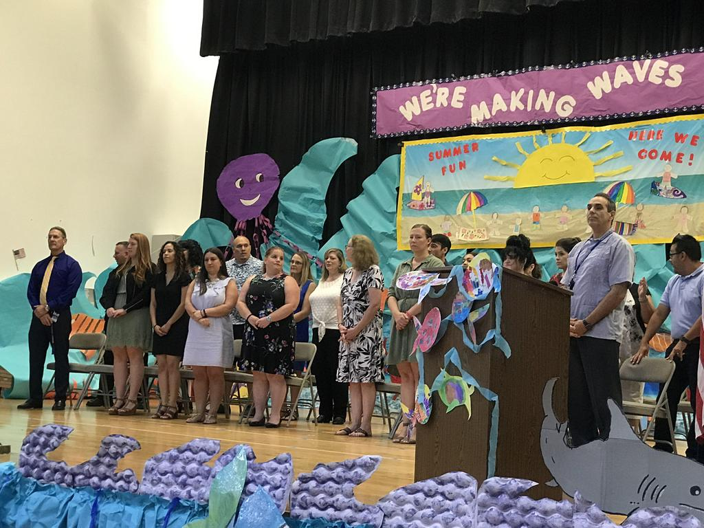 5th grade teachers and admin on the stage