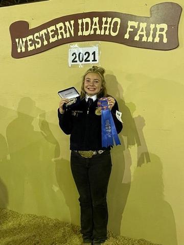 Laney Jo Volkers shows off her ribbon and belt buckler at the Western Idaho Fair