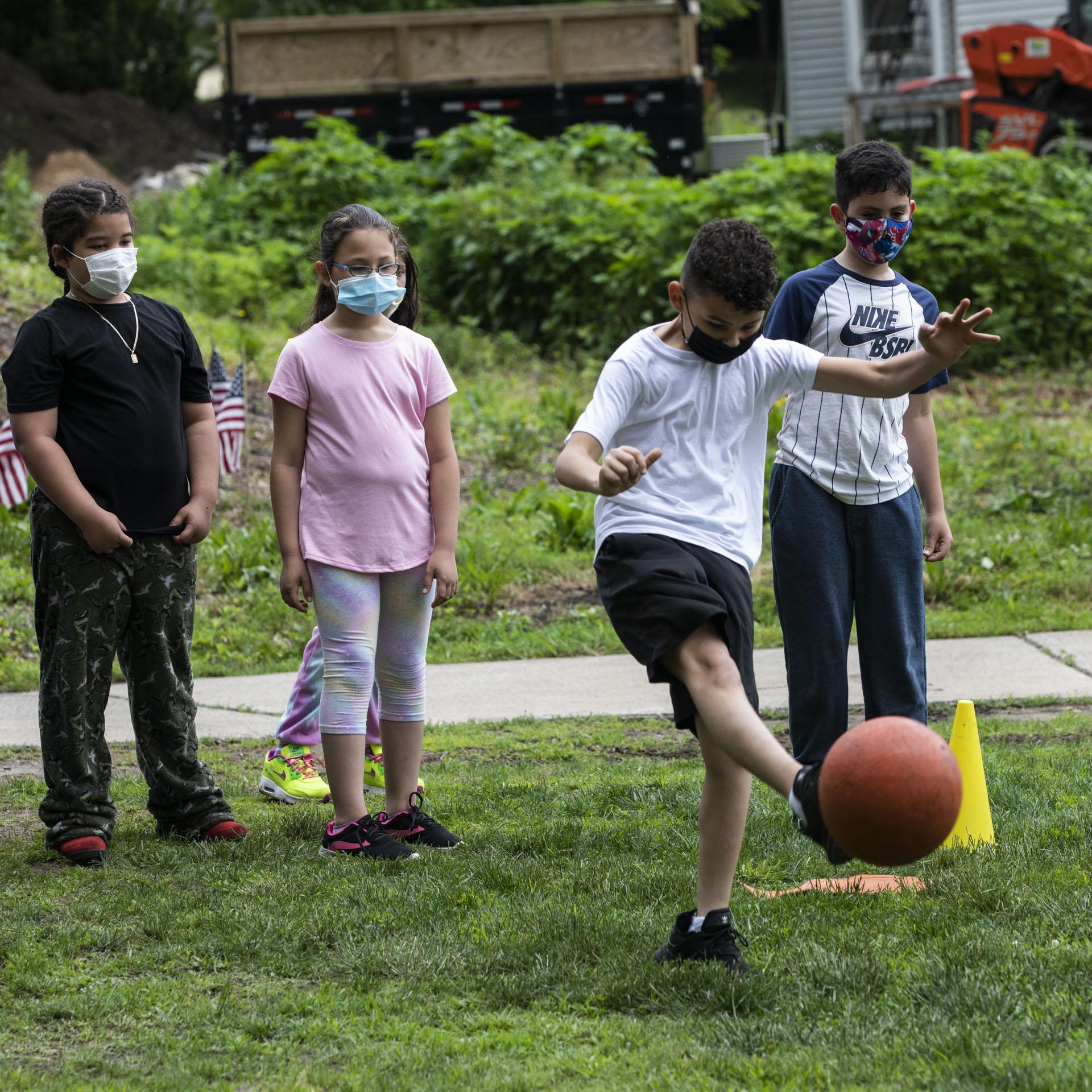 Student kicking ball