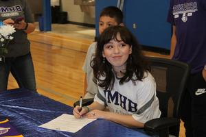 Liliana Gonzalez signing letter of intent