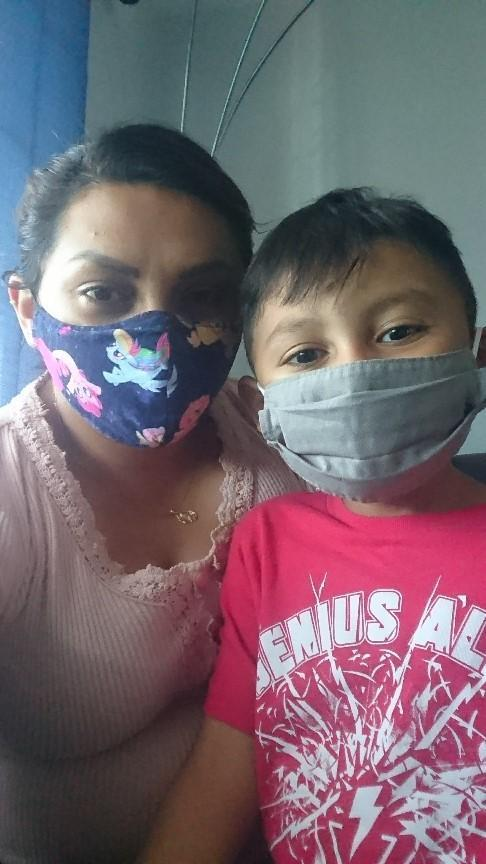 mom & son wearing mask posing for picture