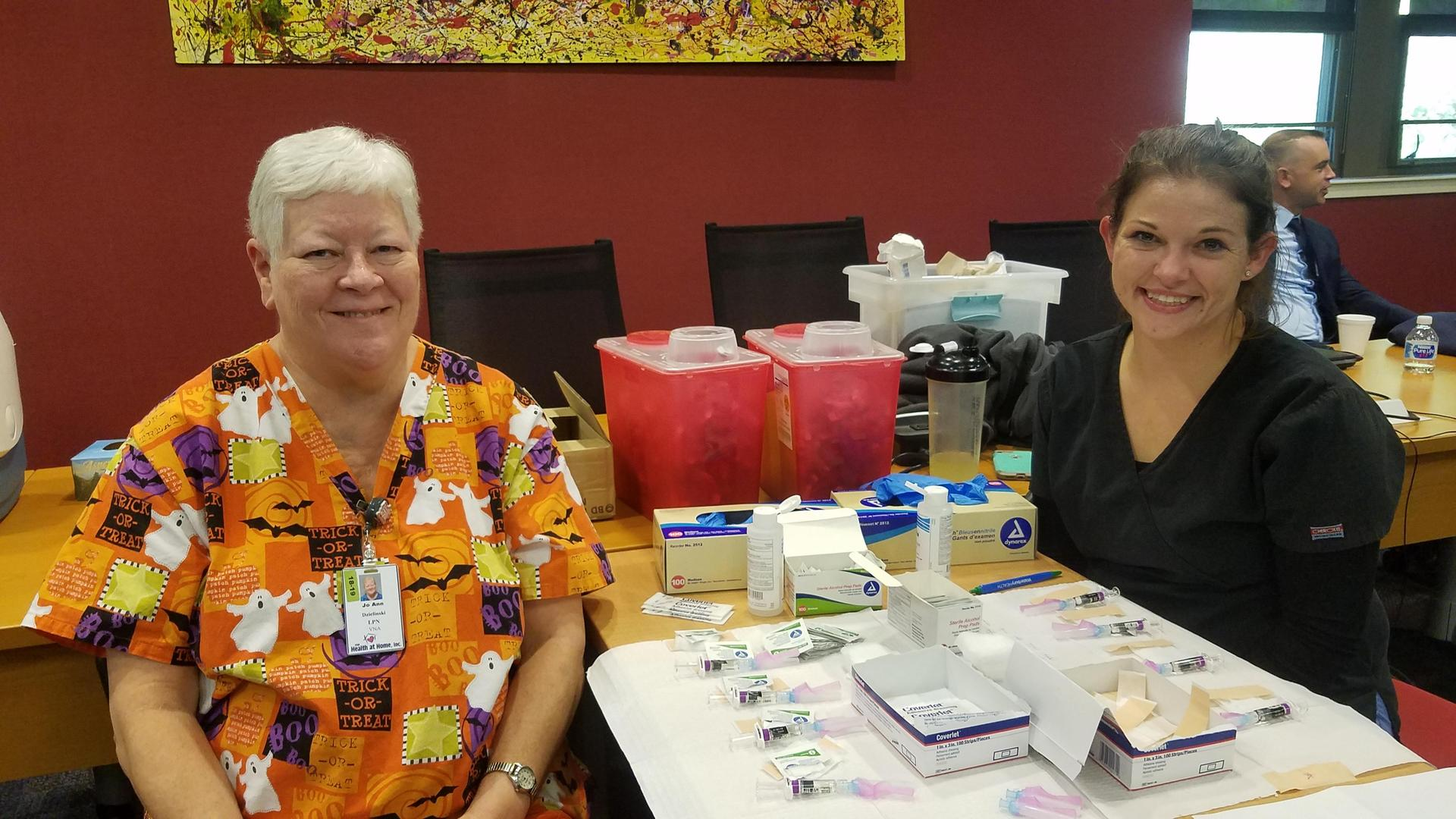 Two nurses with flu vaccines