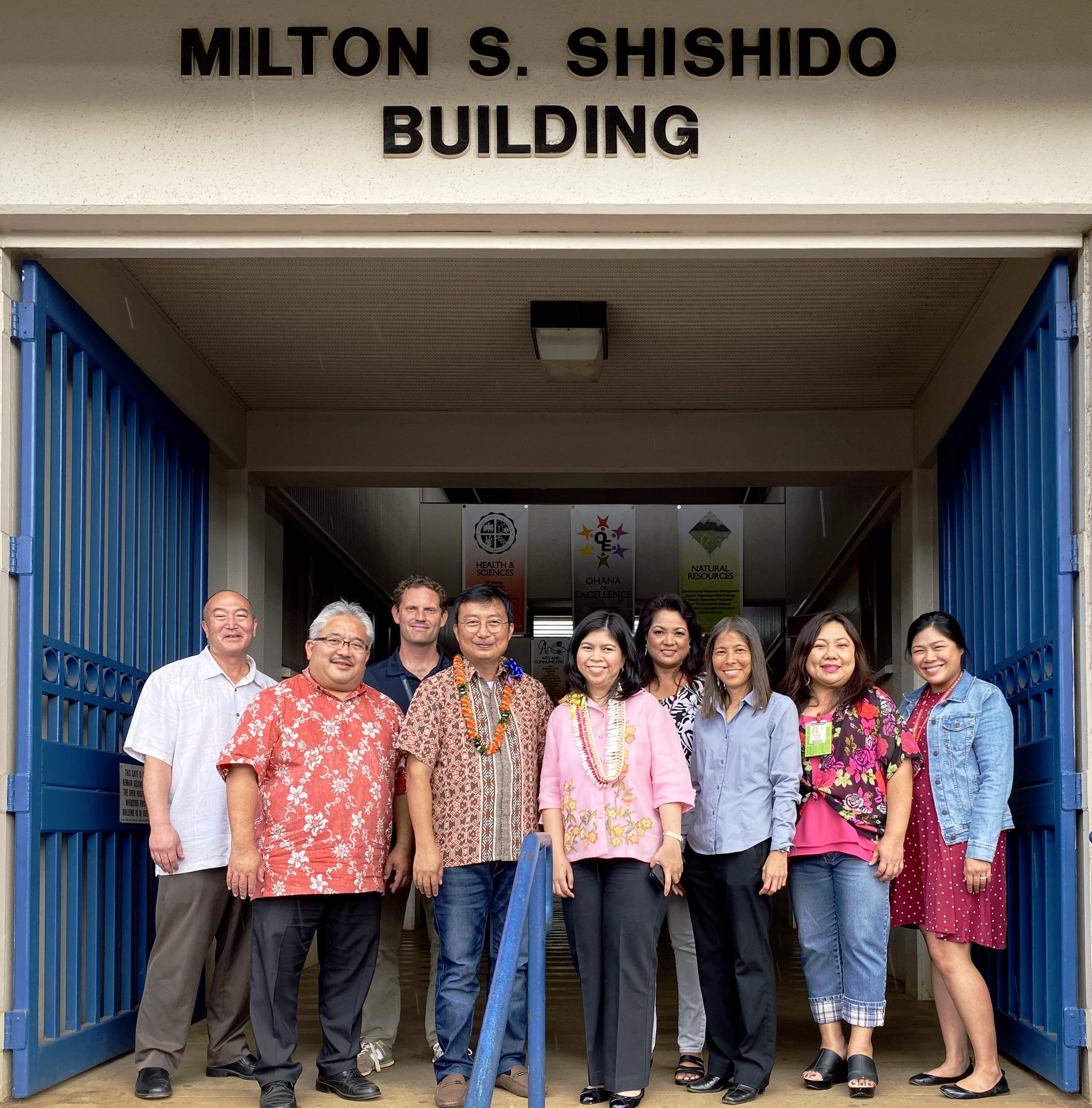 Mr. Joel B. Lopez and Ms. Grace Ann Bulos photographed with Mr. Keith Hayashi, Ms. Meryl Matsumura and group from Waipahu High School