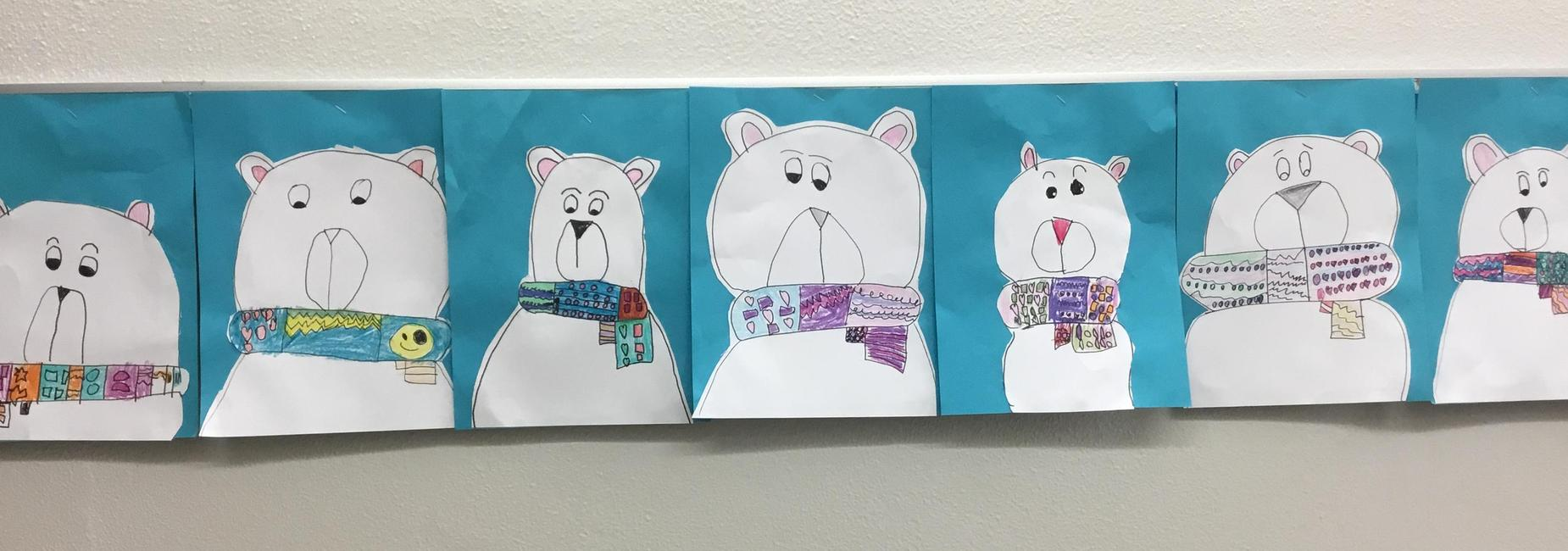 Student drawn polar bears with colorful scarves