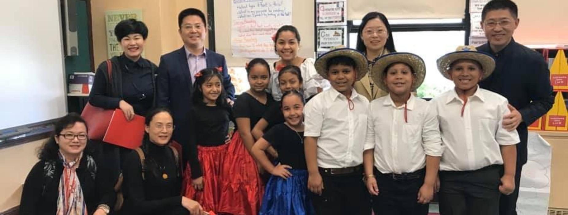 Visitors from The Zheijang Provincial Department of Education congratulate a 3rd grade class after a dance performance.