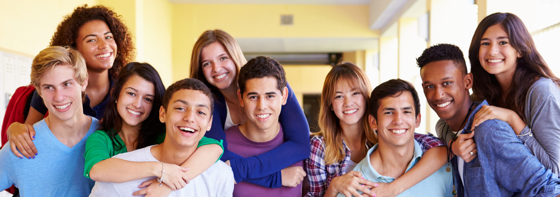 group of teens pose together