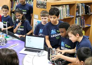 Team Legorio, a group of 6 fourth graders from Jefferson Elementary School, recently demonstrated their robotic prowess before a gathering of their schoolmates as they outlined the challenges they faced during an international robotics competition.