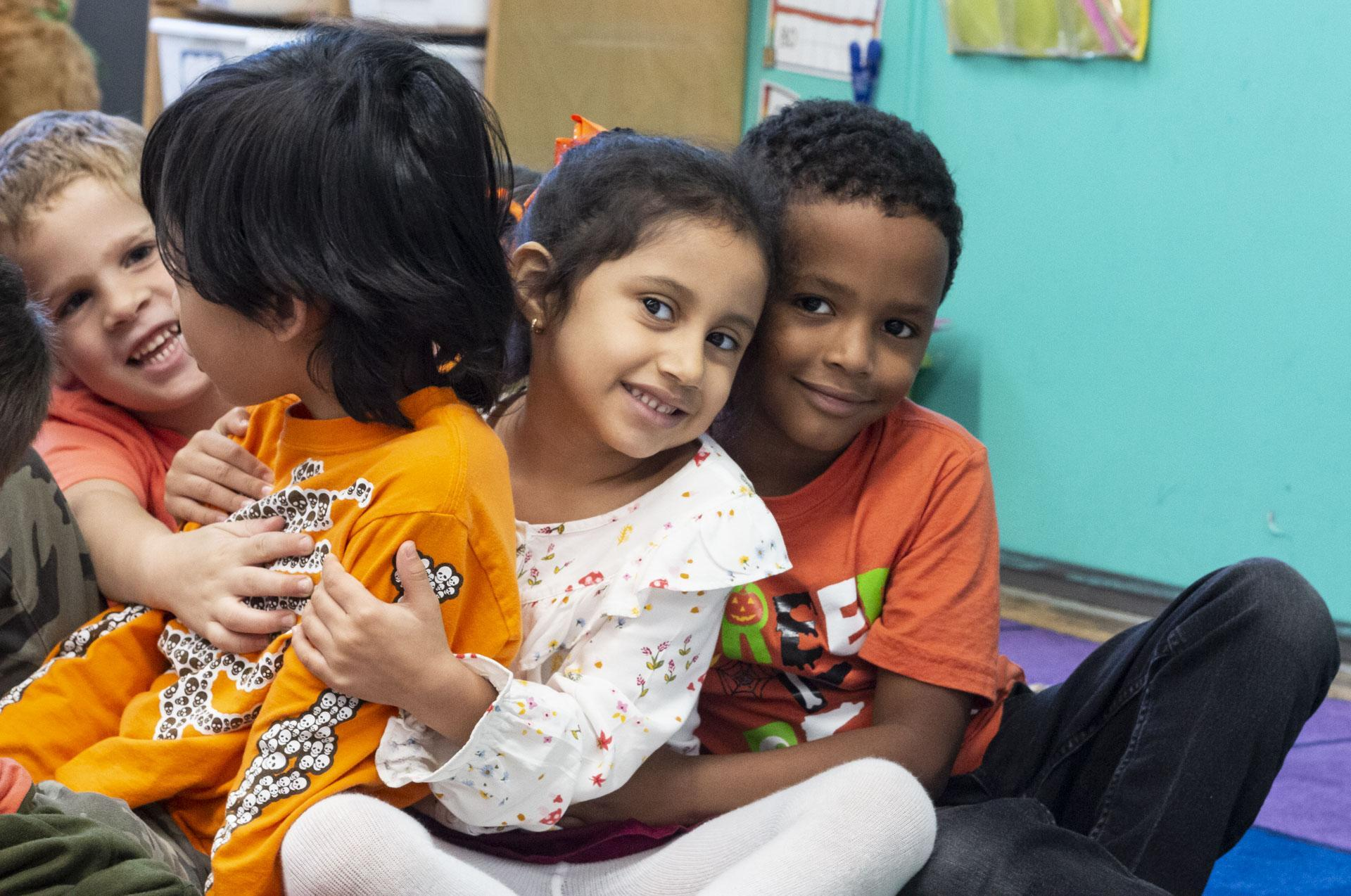 Elementary students hugging each other