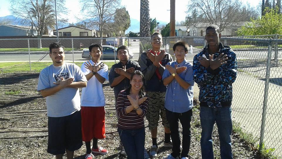 San Bernardino students pose in the garden