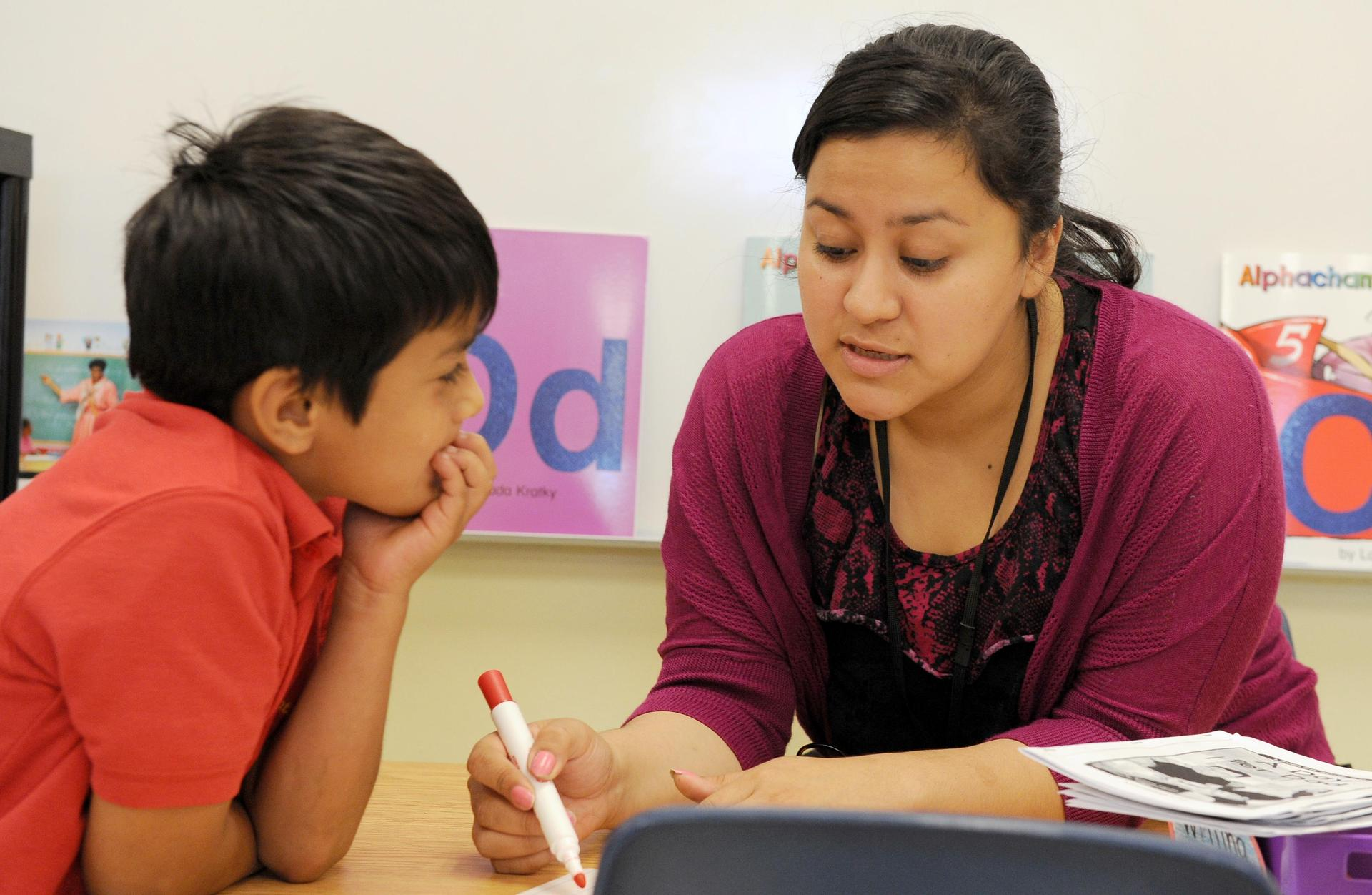 elementary student and teacher