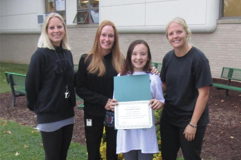 Annabelle with her teachers