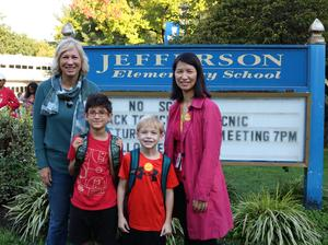 Westfield mayor Shelley Brindle and Jefferson principal Susie Hung pose with students they escorted on Walk to School Day.