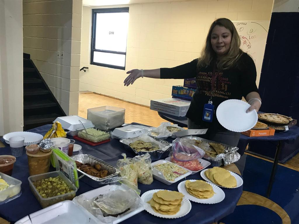 Mrs. Martinez showing off the delicious sides at her table