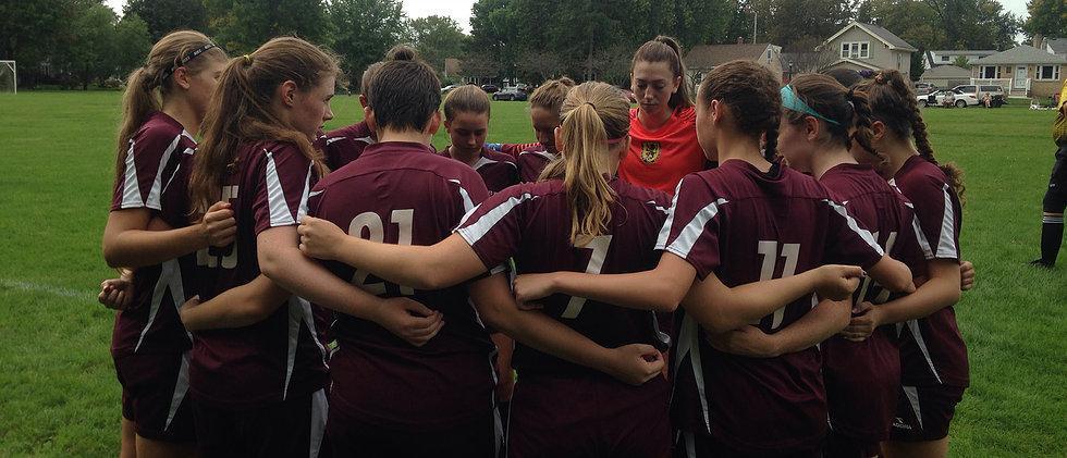 Varsity soccer huddle