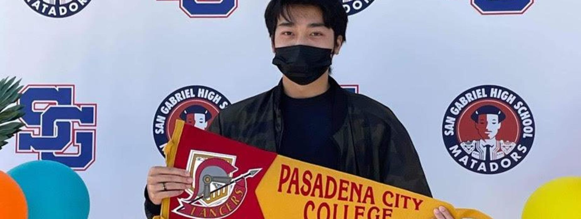 Class of 2021 Graduate holds up PCC sign