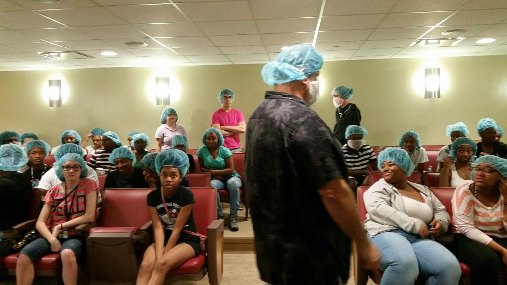 Chef and students preparing for tour with hair nets.