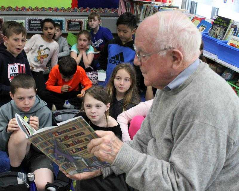 Retiree William O'Herron has been volunteering in Elizabeth Reilly's class each week for the past 12 years.  He is pictured here reading to the class.