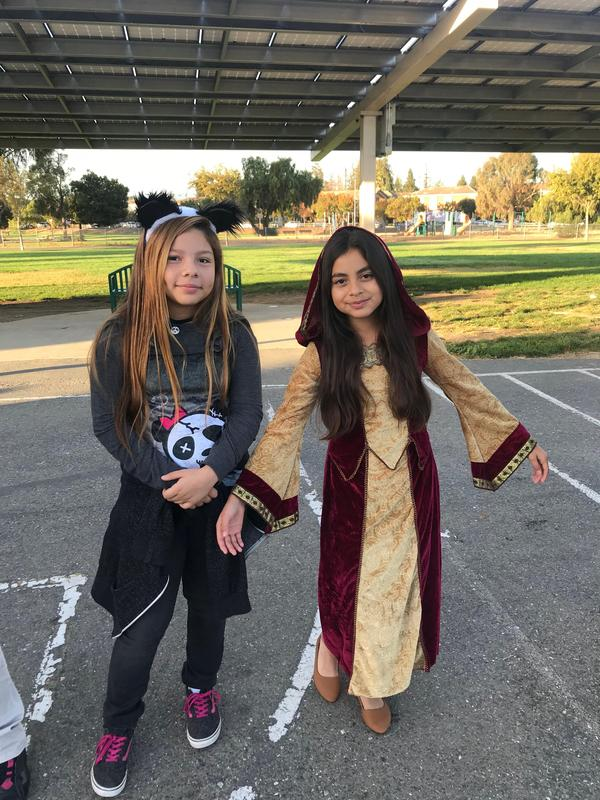 two students showing off their costumes