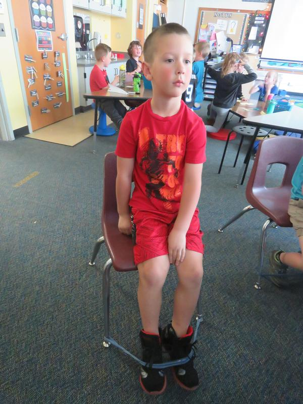 Kick bands give students something to keep their feet active.