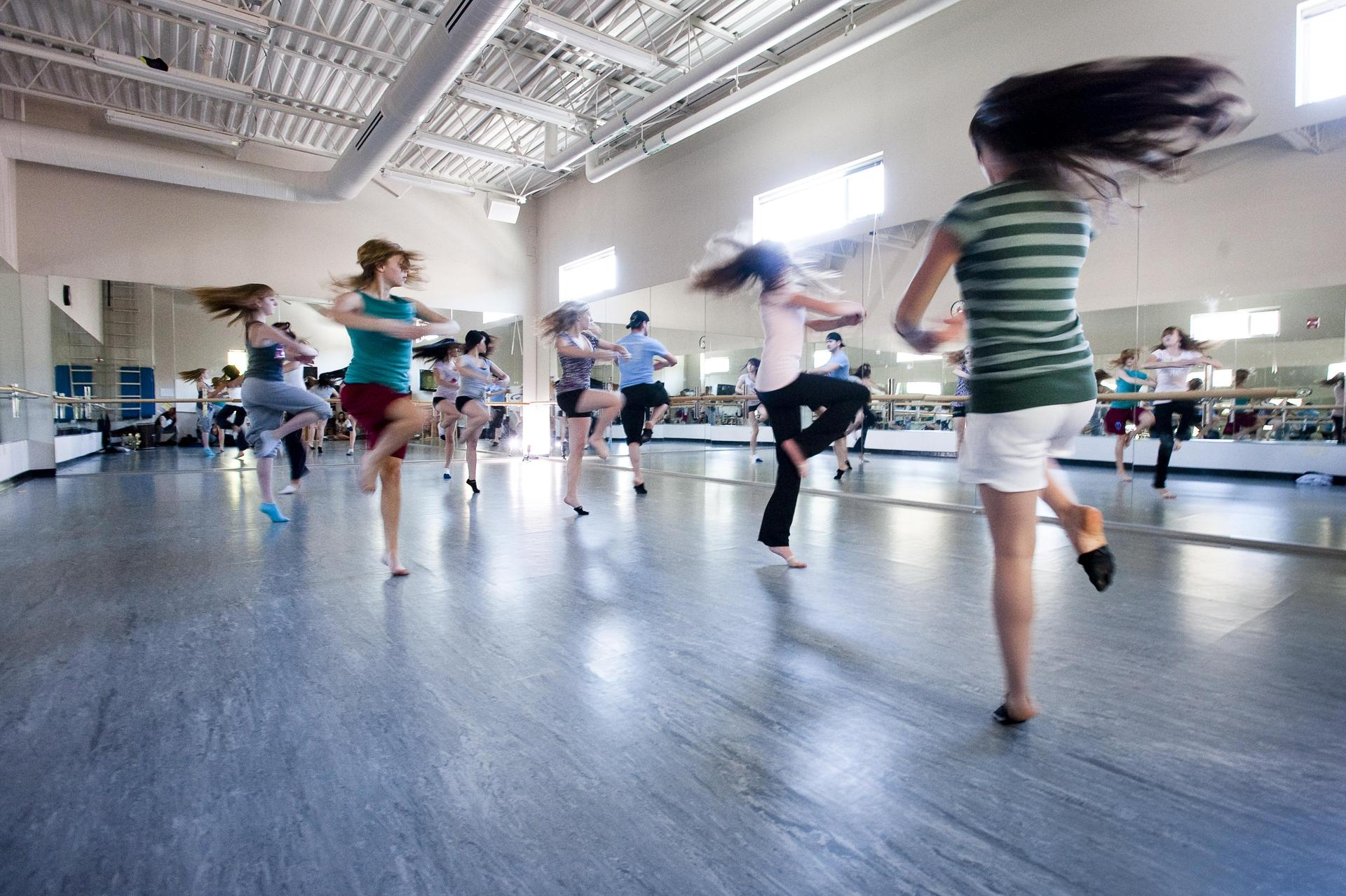 Students dancing in Dance Room with surrounding mirrors