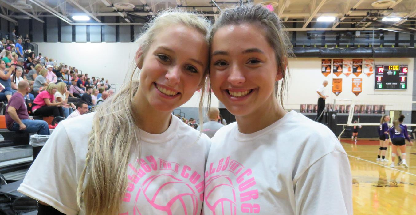 TKHS volleyball players wear a special jersey and pink shorts for the annual Pink Out game.