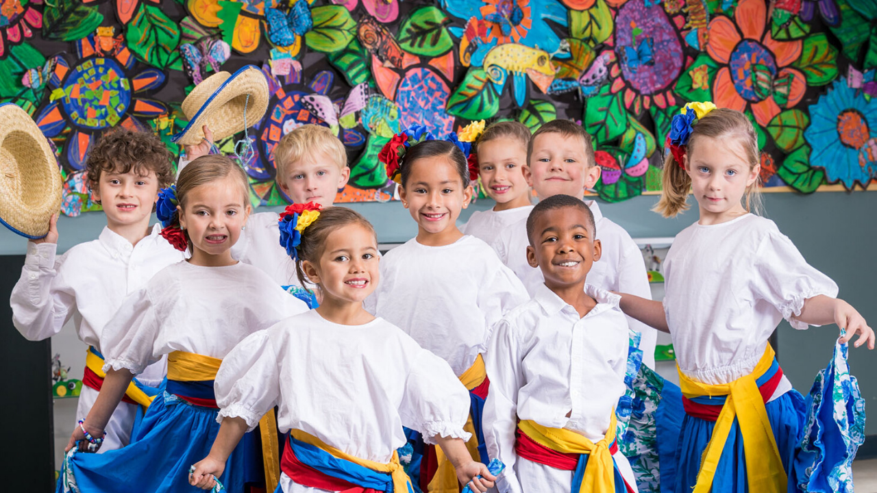 students dressed in Colombian cultural wear