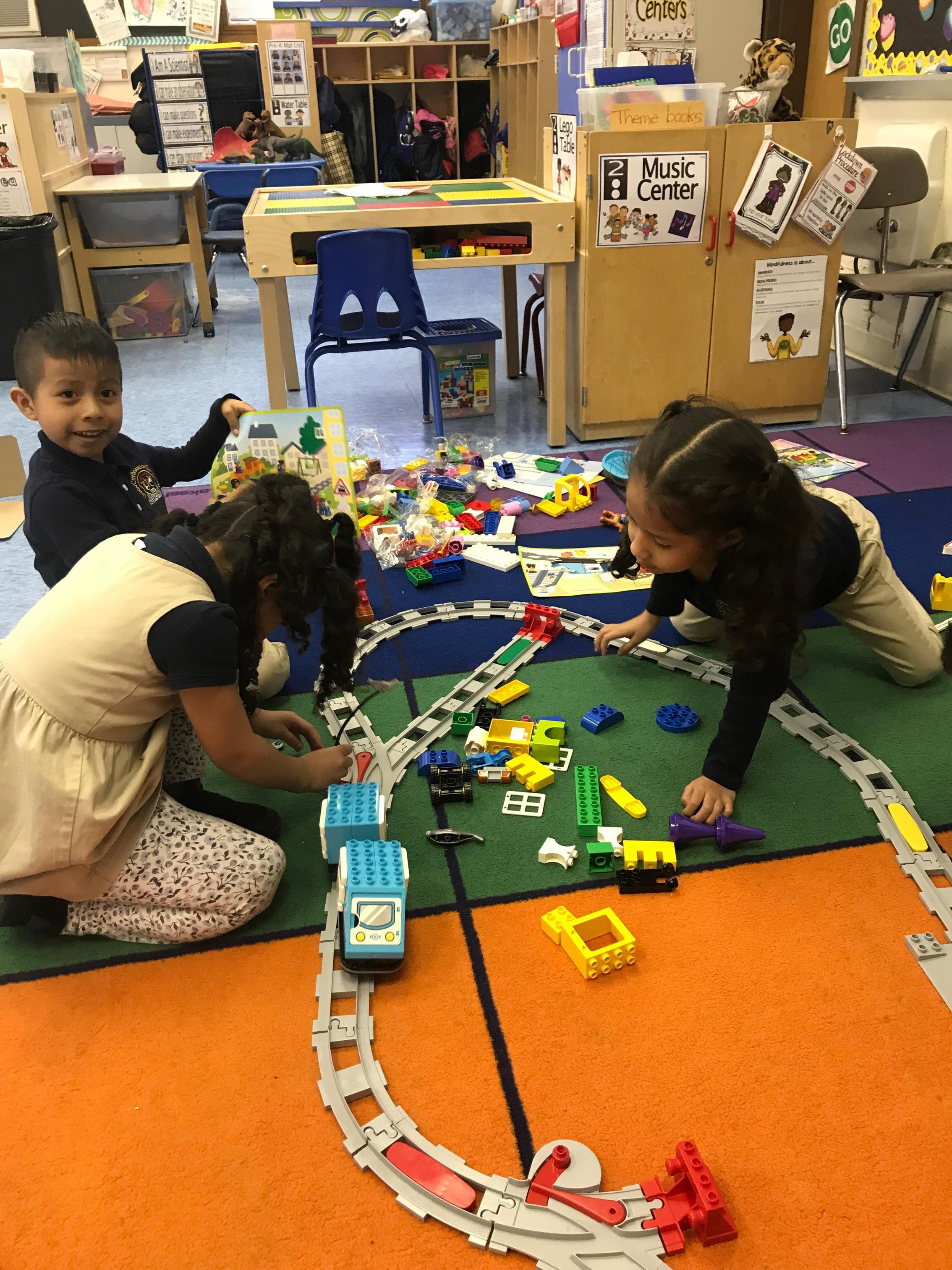 students fixing the tracks
