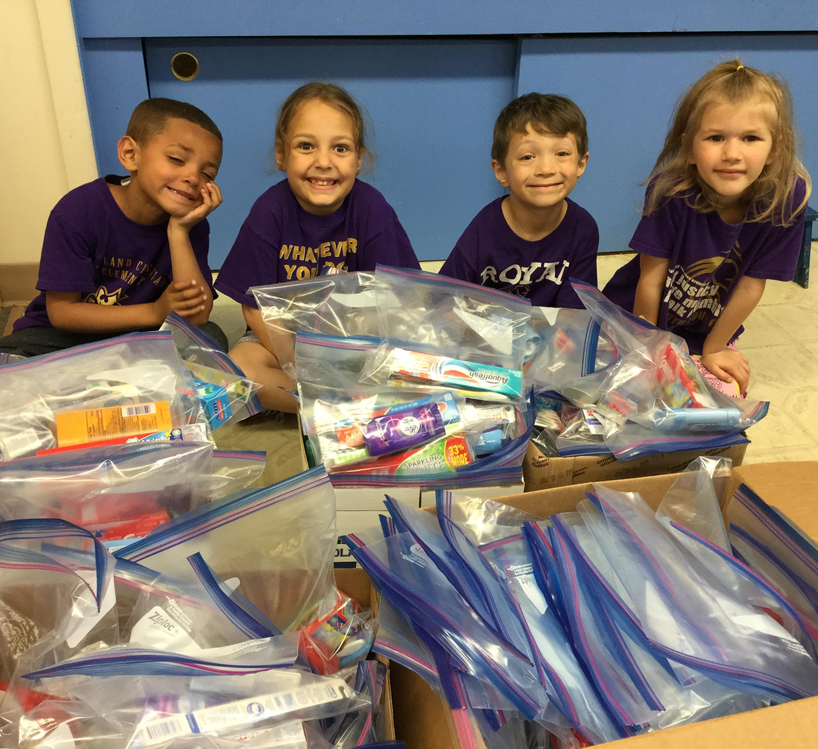 Kindergarteners packing for Kids Closet