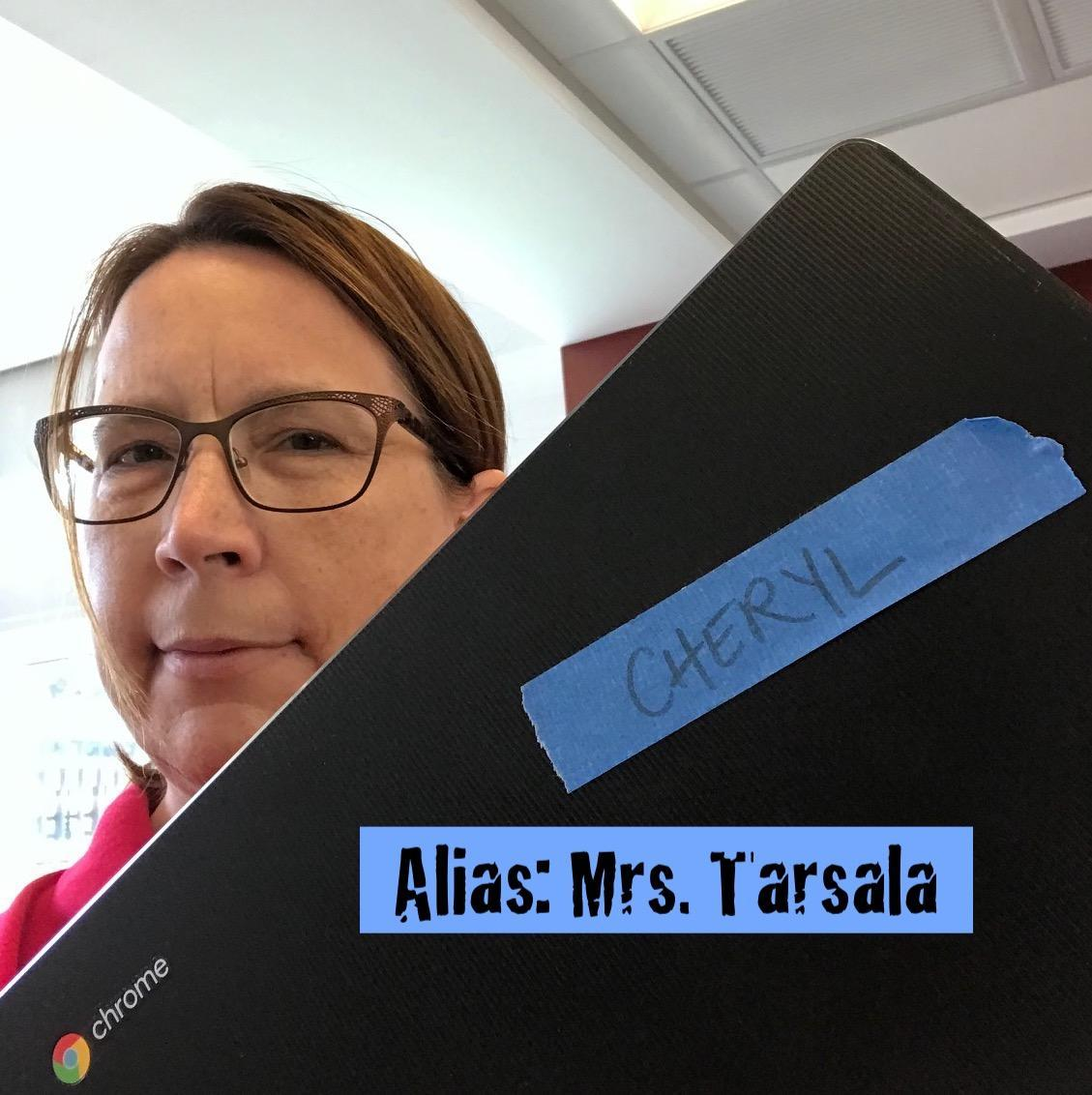 A picture of Mrs. Tarsala hiding behind her Chromebook