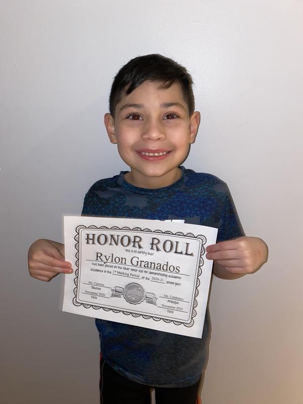 Rylon holding honor roll certificate
