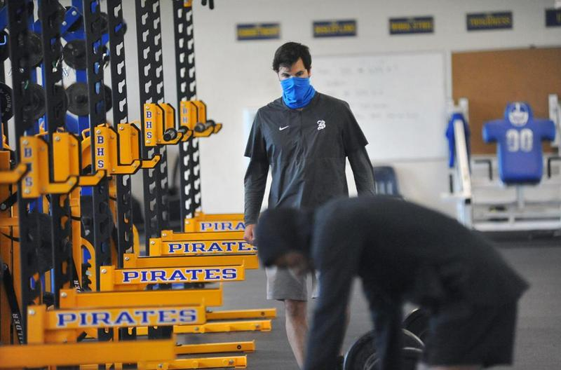 BHS strength and conditioning coordinator William Pannell oversees football player on June 8.