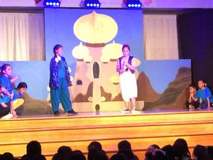 Aladdin performers on stage.
