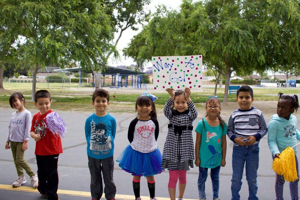 Kindergarten Students holding Congratulations Signs