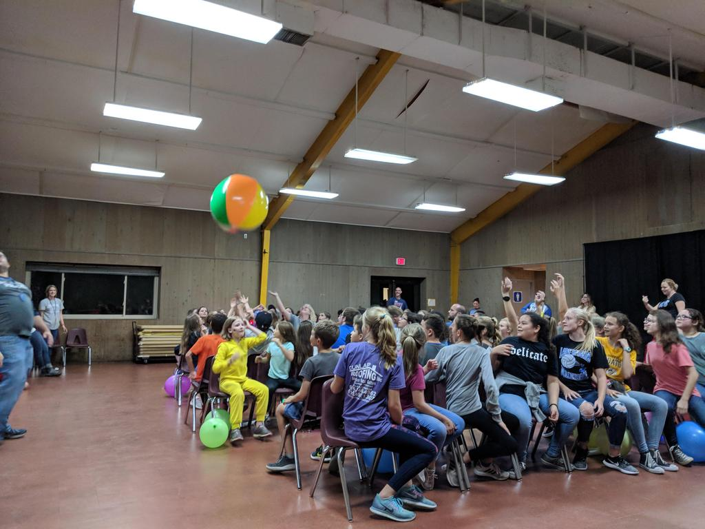Students playing a game with beach balls