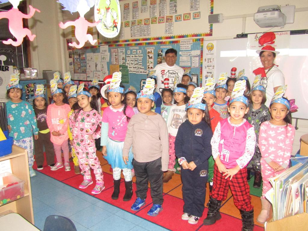 1st grade dressed in their pj's with teacher and aide