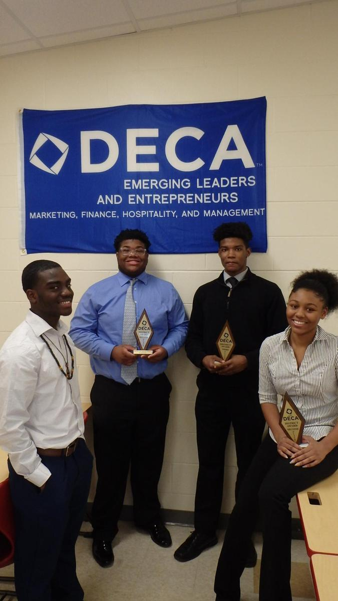 J'Quari, Christian, Tim and Cori at DECA Competition