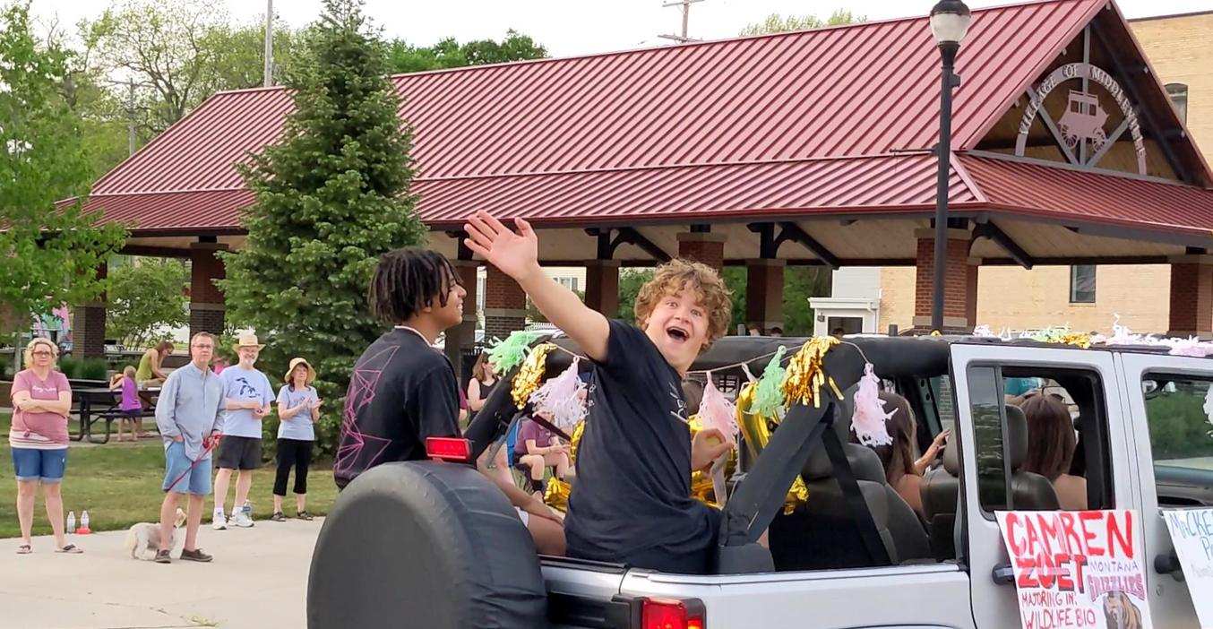 Cam Zoet enjoys the senior cruise, waving to friends along the way.
