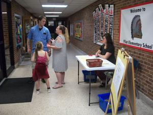 Parents and student at sign-in.