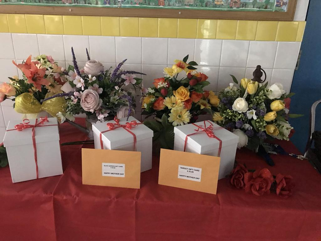 four bouquets of flowers with three gift boxes and two gift cards