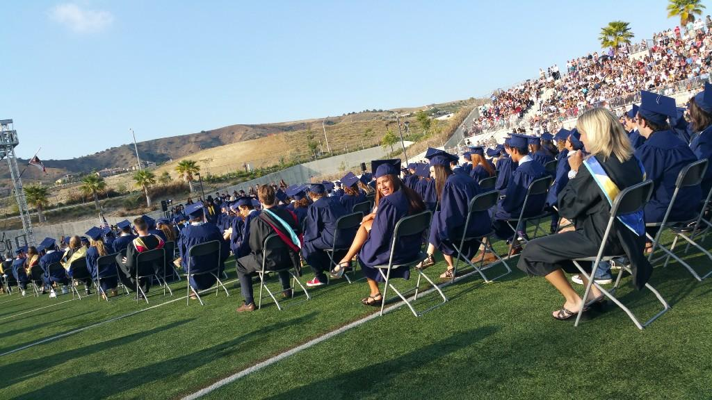 On the field at graduation