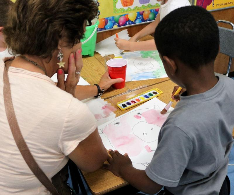 Photo of kindergartner Drawing and painting as part of an Extended School Year (ESY) program for students identified as those who would benefit from additional instruction and related services in the summer.