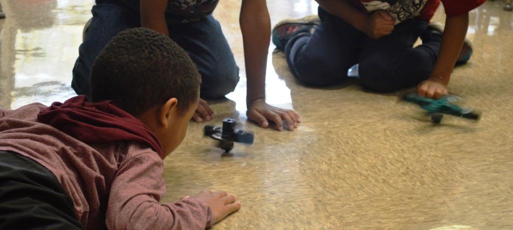 kindergartners play with spinners