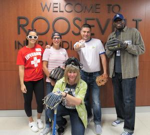 Photo of RIS principal, asst principal, and other staff dressed as baseball players for Halloween