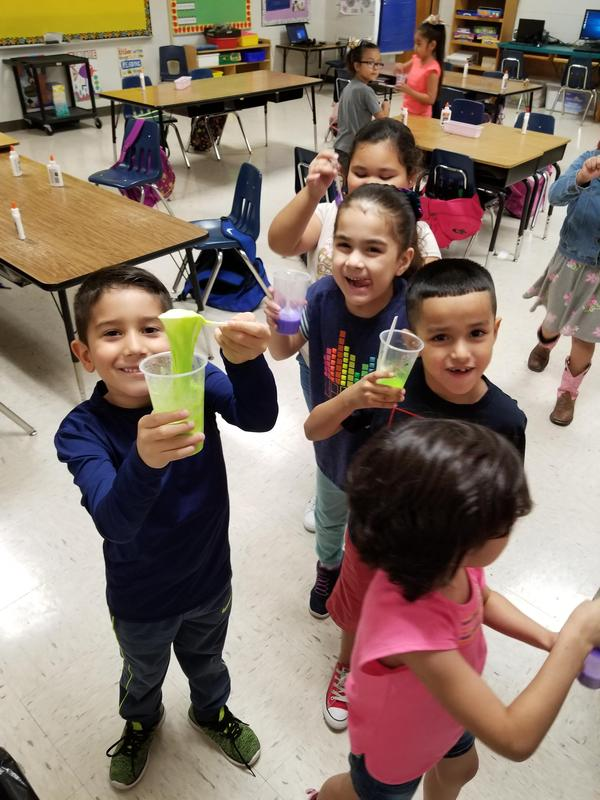 First grade students show off their slime creations.