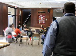 Andre Taylor (right), a representative of the office at the New Jersey Department of Education that oversees the department's initiative on Social and Emotional Learning (SEL), observes a session of the Transition Program at Westfield High School on Jan. 11.